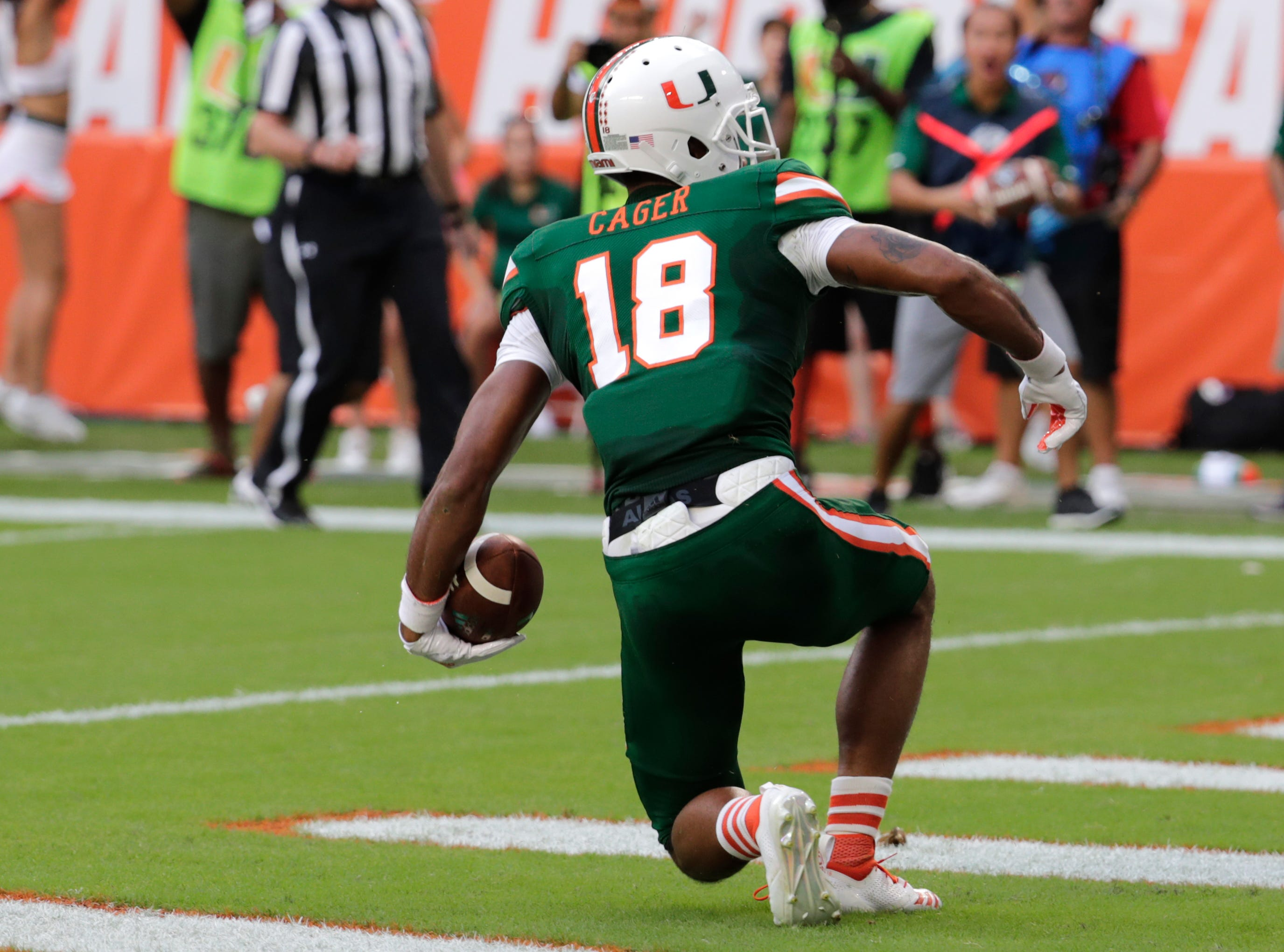 Miami wide receiver Lawrence Cager (18) scores a touchdown during the first half of an NCAA college football game against Florida State, Saturday, Oct. 6, 2018, in Miami Gardens, Fla. (AP Photo/Lynne Sladky)