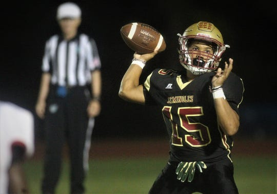 Florida High quarterback Bryson Hill throws a pass during the Seminoles' 19-14 win in the final seconds against NFC.