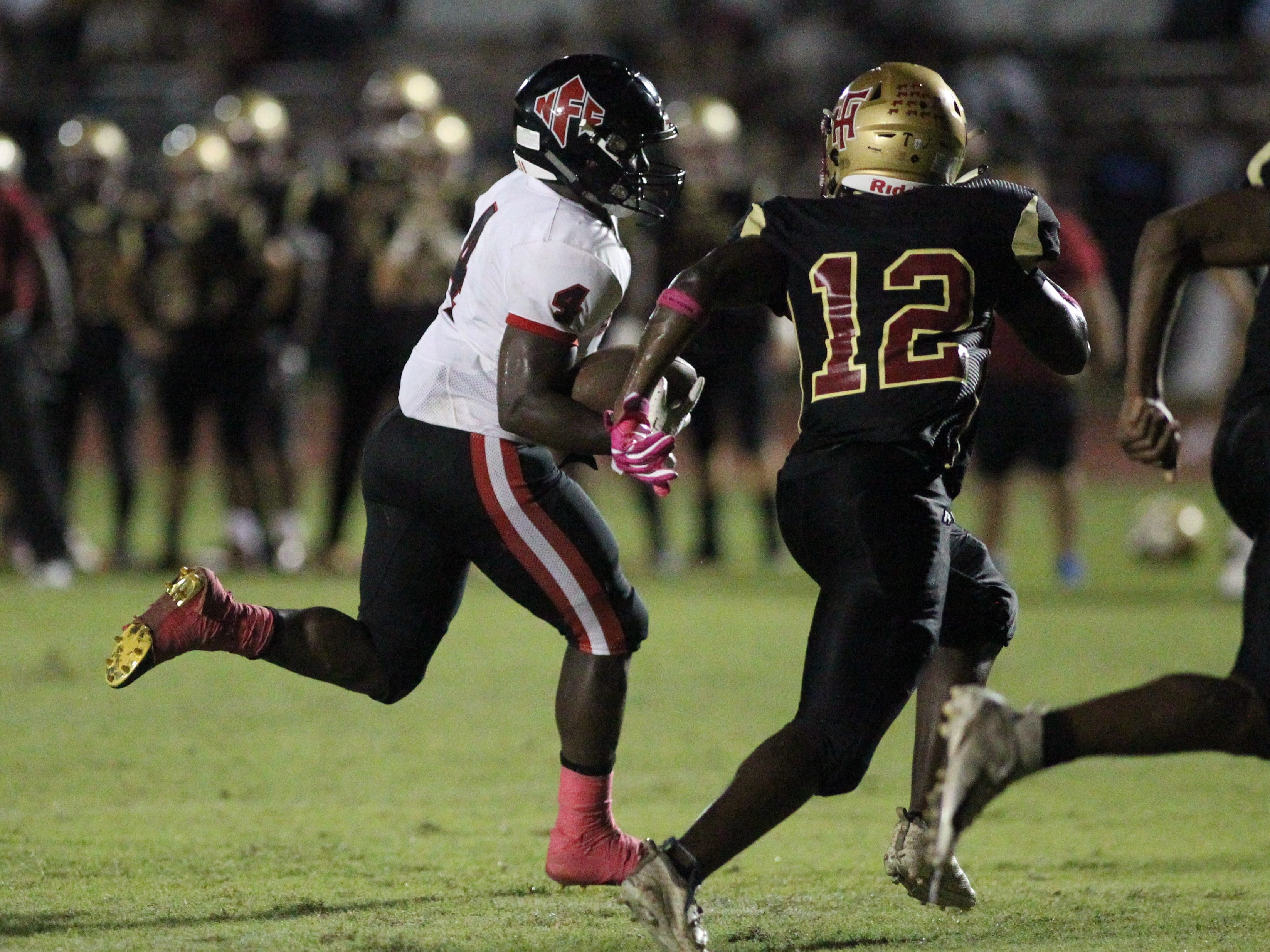 NFC running back Deon Cosby streaks towards the goal line during a game against Florida High.