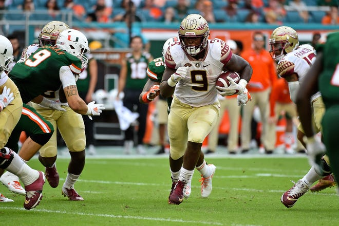 Oct 6, 2018; Miami Gardens, FL, USA; Florida State Seminoles running back Jacques Patrick (9) runs the ball against the Miami Hurricanes during the first half at Hard Rock Stadium. Mandatory Credit: Jasen Vinlove-USA TODAY Sports