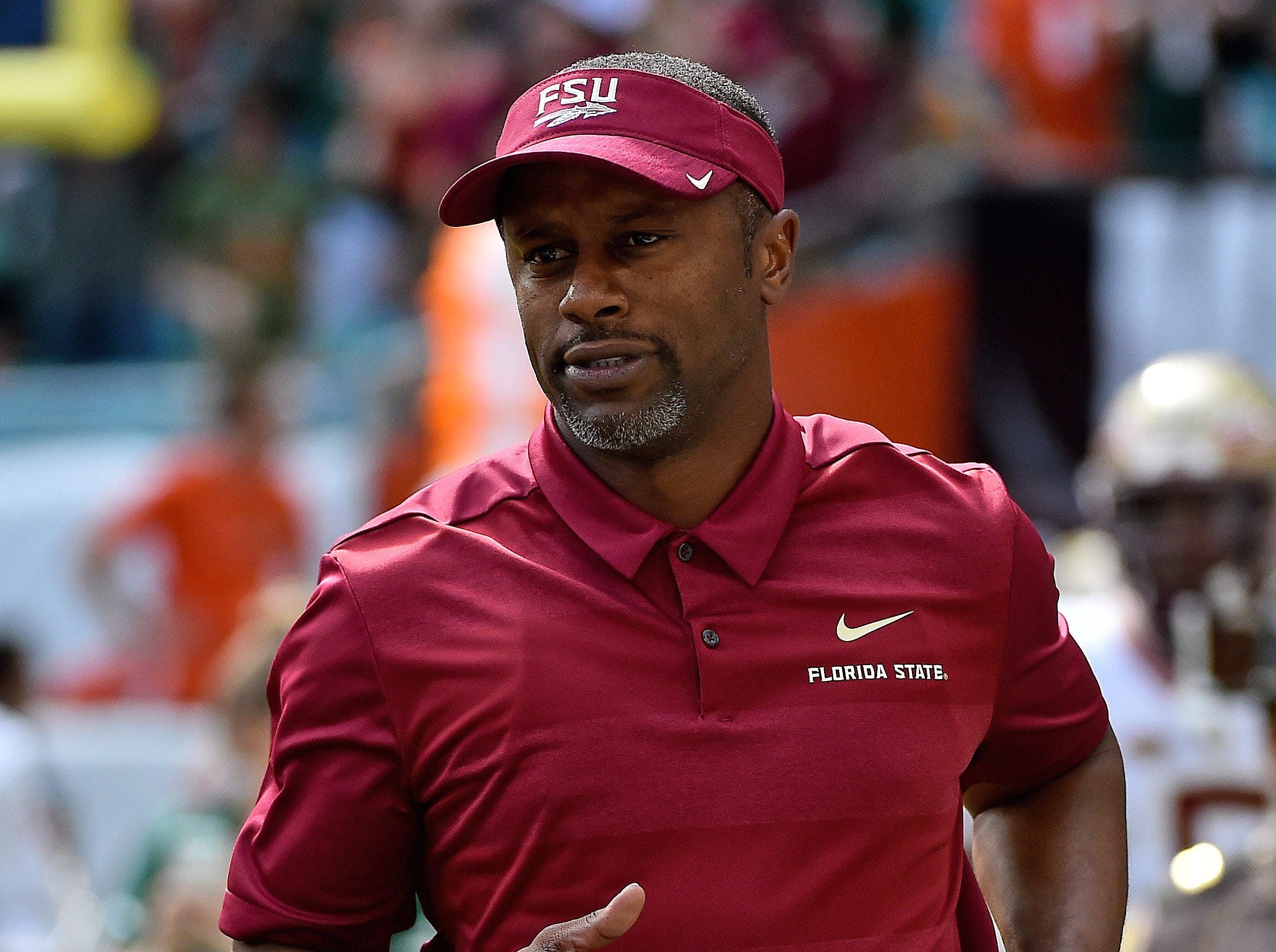 Oct 6, 2018; Miami Gardens, FL, USA; Florida State Seminoles head coach Willie Taggart runs onto the field prior top the game against the Miami Hurricanes at Hard Rock Stadium. Mandatory Credit: Jasen Vinlove-USA TODAY Sports
