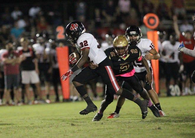 NFC running back Jonathan Railey runs for a big gain as Florida High's Javan Morgan tries to bring him down.