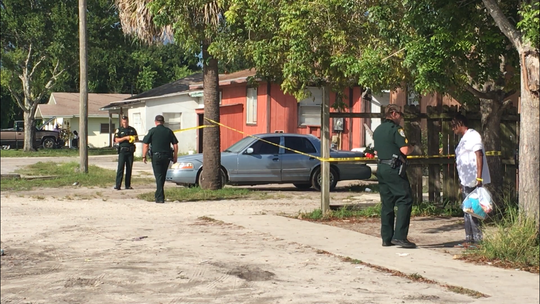 Deputies for the Indian River County Sheriff's Office talked with people at the scene of a shooting on 33rd Avenue on Saturday, Oct. 6, 2018.