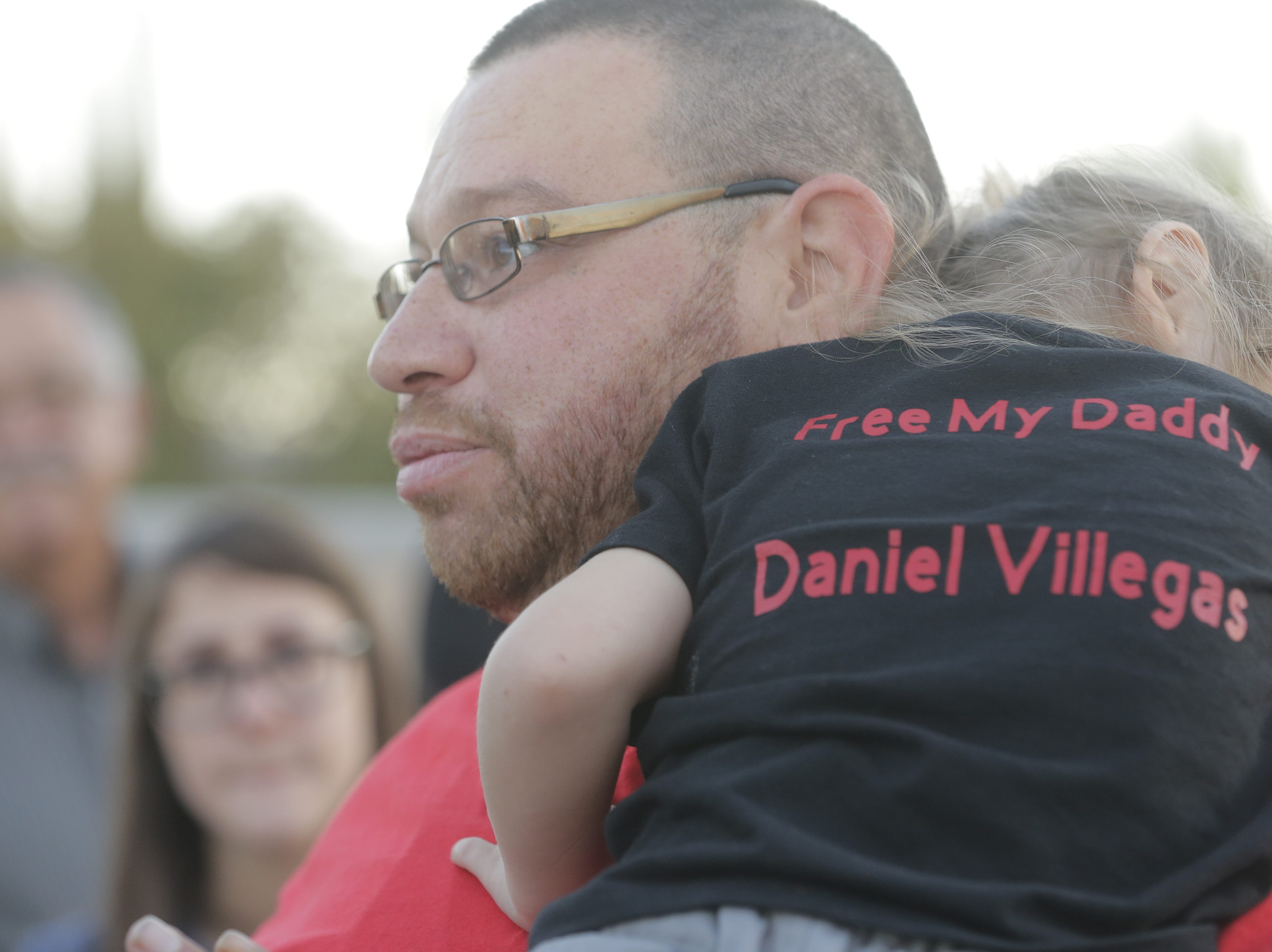 Daniel Villegas with his daughter after his trial.