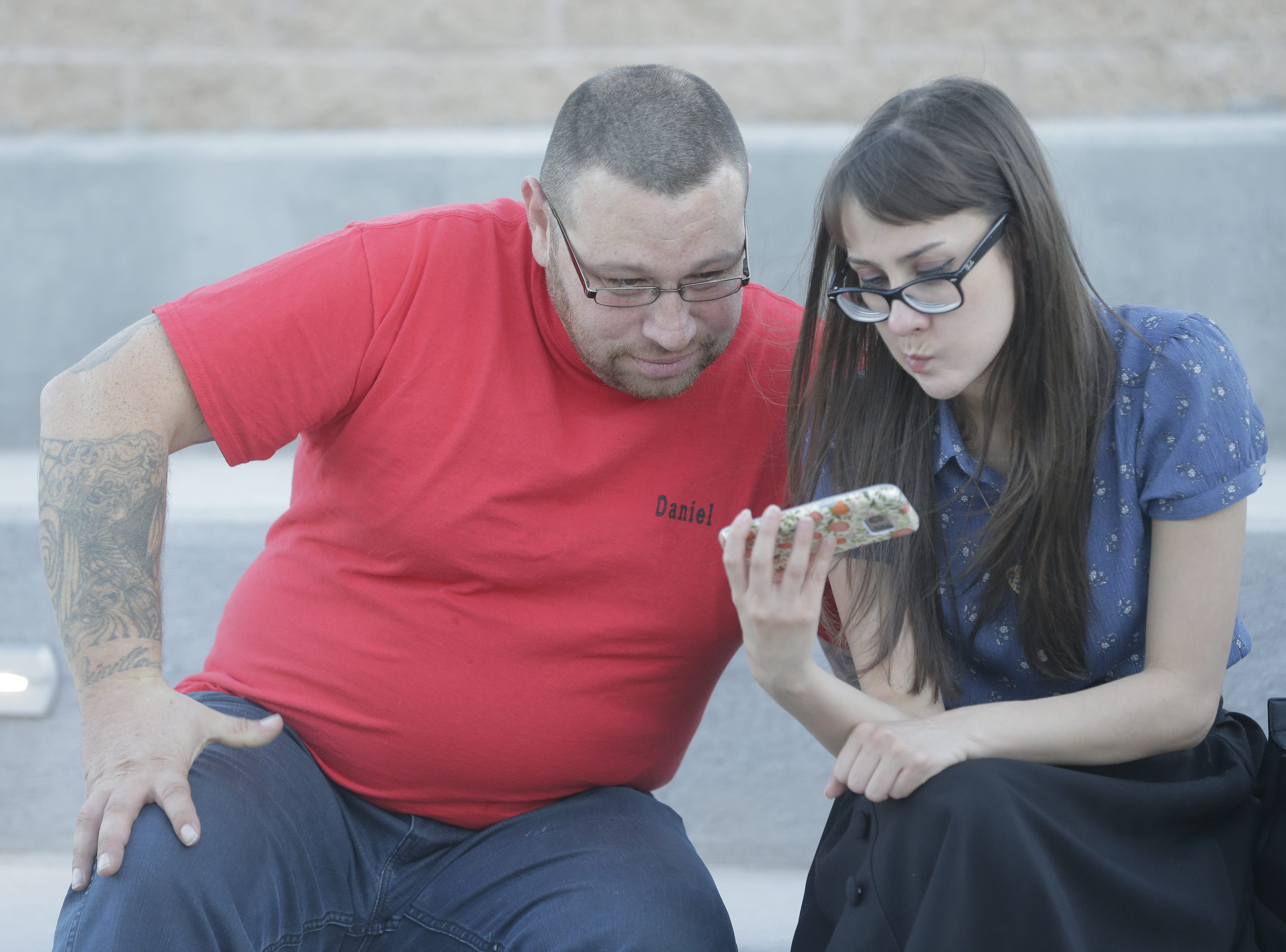 Newly exonerated Daniel Villegas and his cousin Andrea Rangel watch footage of his trial shortly after it ended. They were outside church right after a jury found him not guilty of the 1993 murders of two El Paso teens. Rangel is the sister of David Rangel, who testified that Villegas was joking when he confessed to shooting the teens.