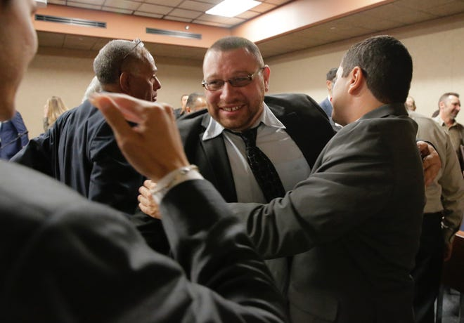 Daniel Villegas receives congratulations as he leaves the courtroom.