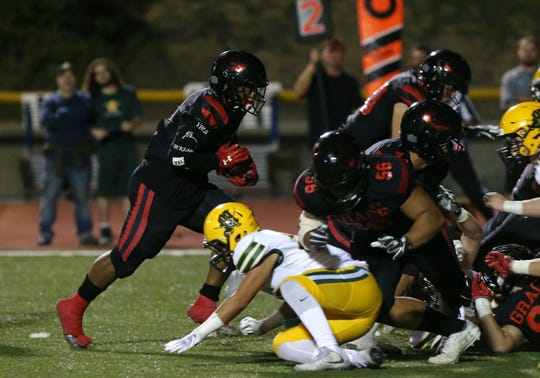 Grace Brethren's Lontrelle Diggs runs for the game's first touchdown during the Lancers' 39-7 win over Moorpark in a Camino League game at Moorpark College.