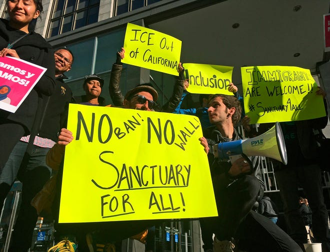 In this April 14, 2017, file photo, protesters rally outside a courthouse in San Francisco.