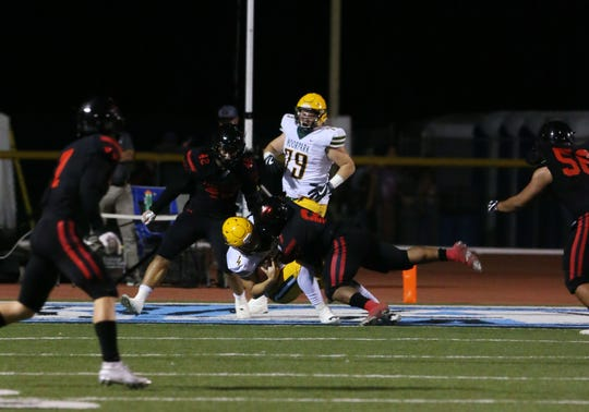 Grace Brethren's Lontrelle Diggs tackles Moorpark quarterback Blake Sturgill in the end zone for a safety during Friday night's game at Moorpark College.