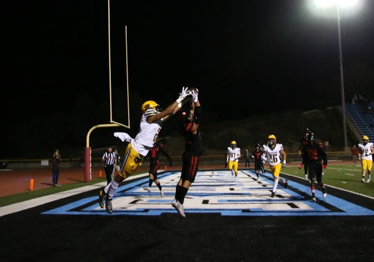 Grace Brethren's Troy Hothan goes up to make an interception in the end zone against Moorpark during a game earlier this season.