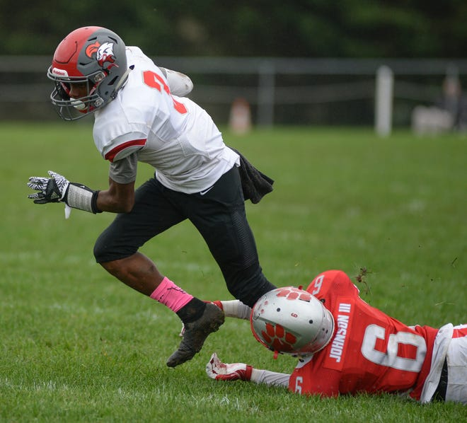 Vineland's Jonathan Toney breaks a tackle by St. Joseph's Nate Johnson during a game on Oct. 6. The sophomore has developed into one of the team's most productive receivers this season.