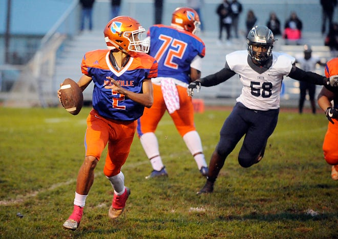 Millville QB, Eddie Jamison (2) checks downfield against visiting Timber Creek. The Thunderbolts defeated the Chargers 42-20 on Friday, October 5, 2018.