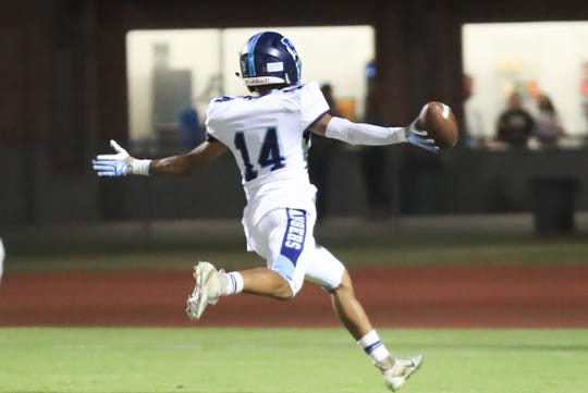 Redwood's La'Dre Aguilar celebrates a touchdown during a West Yosemite League High School Football game at Visalia Community Stadium on Sept 5th, 2018.