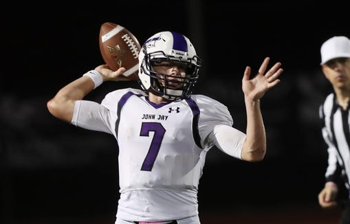 John Jay (CR) quarterback Bryce Ford readies to throw during Friday's game against Our Lady of Lourdes.