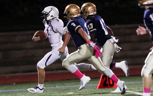 John Jay (CR) Bryce Ford (7) looks for some running room in the Lourdes defense during football action at Our Lady of Lourdes High School Oct. 5, 2018. John Jay won the game 49-28.