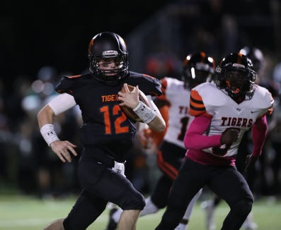 Mamaroneck quarterback Tommy Dillon (12) with the carry durint their 55-41 win over White Plains football action at Mamaroneck High School on Friday, October 5, 2018.