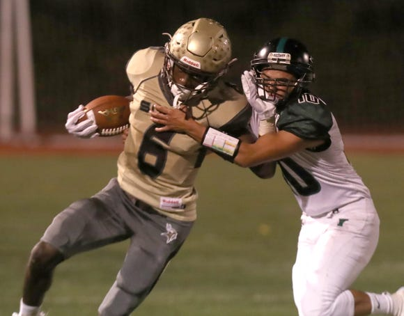 Clarkstown South's RJ Lamarre pushes past Yorktown's Nick Campanaro during their game at Clarkstown South Oct. 5, 2018. Clarkstown South won 27-7.