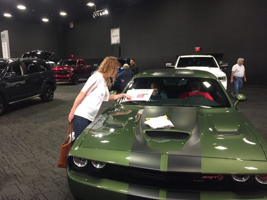 On Saturday, Wilmington's Chase Center swarmed with people eager to see, touch and sit behind the wheels of the latest model cars on display at the 12th annual Delaware Auto Show. The auto show continues Sunday from 10 a.m. to 6 p.m. at the Chase Center on the Riverfront, 815 Justison St. in Wilmington.