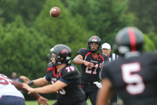St. Andrew's quarterback Theodore Jaffe throws a pass toward Adrian Watts (5) during the Saints' 32-7 win over First State Military Academy on Friday.
