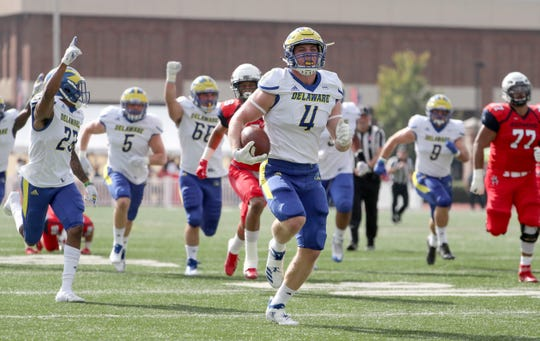 Delaware's Colby Reeder comes away with the ball and a touchdown after stripping the ball from a Richmond receiver following a catch in the first quarter at Richmond Saturday.