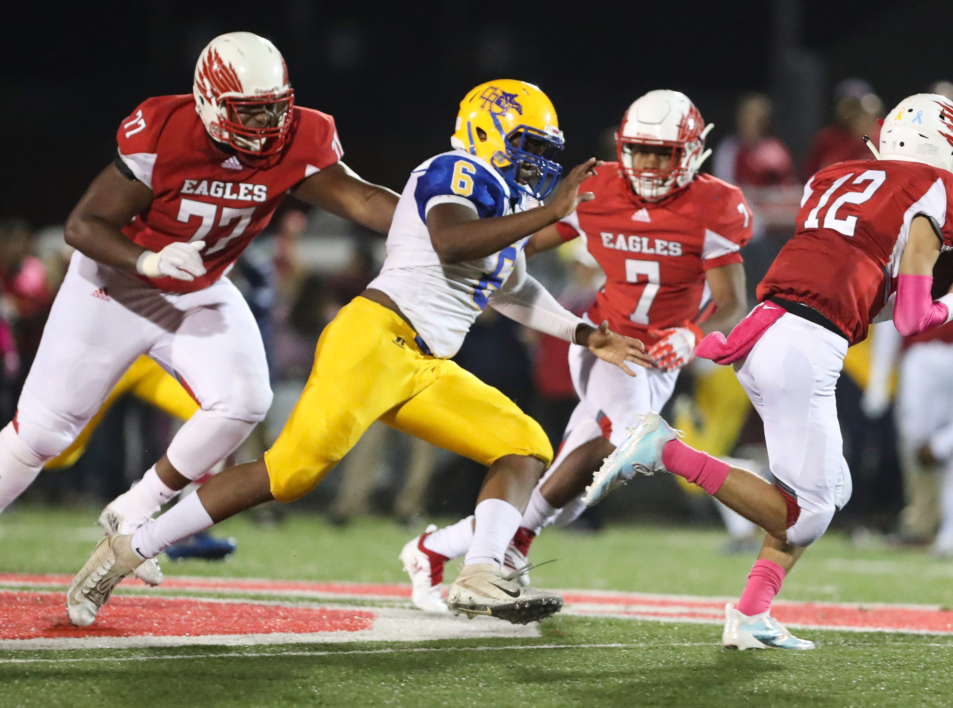 Caesar Rodney's William Burke (6) pursues Smyrna quarterback Aidan Sanchez as he is in turn pursued by Saleem Wormley (77) and Stephen Whaley in the first quarter at Smyrna Friday.