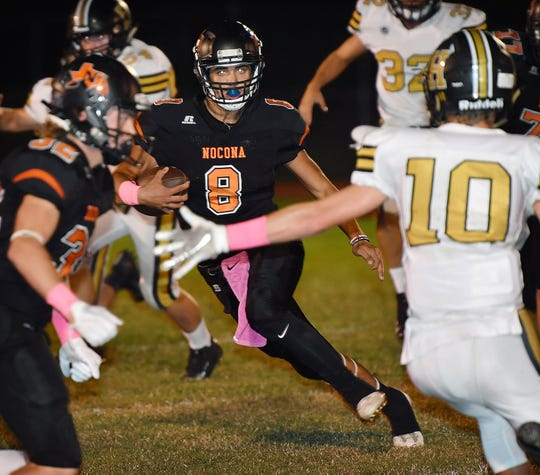 Nocona quarterback Carter Horn (8) cuts outside with a run against the Henrietta Bearcats Friday night in Nocona.