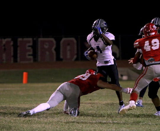 City View's Chris Graham (4) is brought down by Holliday's Connor Hill (39) on Friday, Oct. 5, 2018 in Holliday.