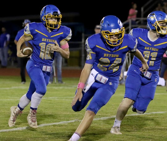 Bryson's Harley Hammond runs behind his blockers in the game against Crowell Friday, Oct. 5, 2018, in Bryson. The Wildcats defeated the Cowboys 79-31.
