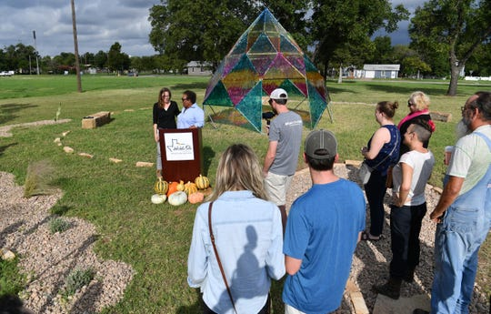 Margie Reese, executive director of the Wichita Falls Alliance for Arts and Culture, introduces Audra Lambert, left, project manager for the Wichita Dome public art installation, Saturday morning during the opening ceremony.