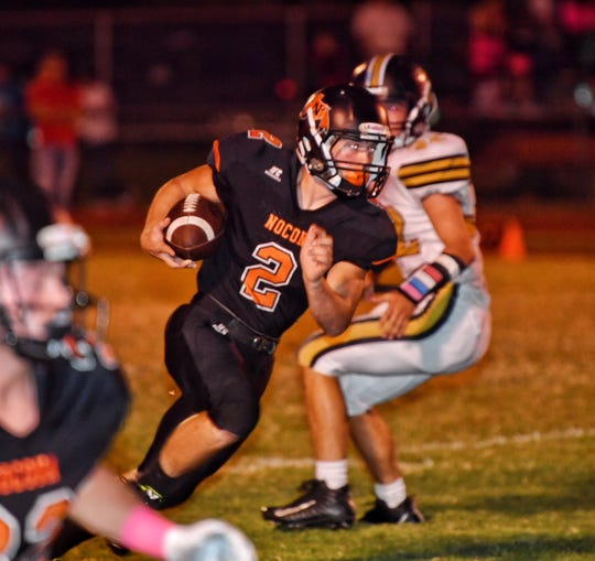 Nocona Indians running back Logan Barnes picks up good yardage on the opening touchdown drive against Henrietta Friday night in Nocona.