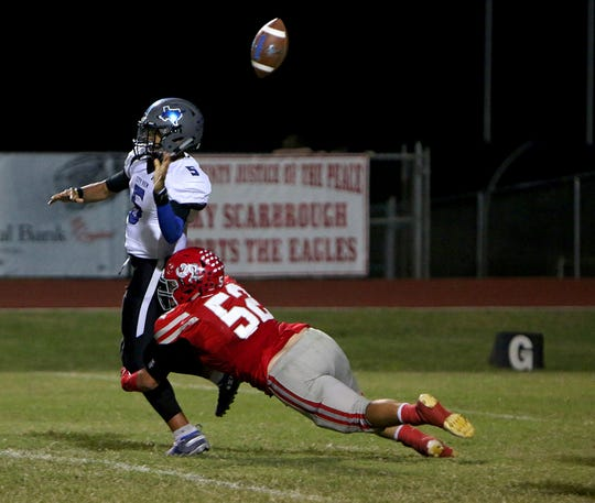 City View quarterback Isaiah Marks (5) fumbles the ball as he's brought down by Holliday's Jake Turner (52) on Friday, Oct. 5, 2018 in Holliday.