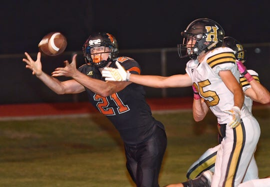 Nocona receiver Jason Sparkman (21) catches a TD pass in front of Henrietta defender Brandon Lee for a 12-7 halftime lead in Nocona.