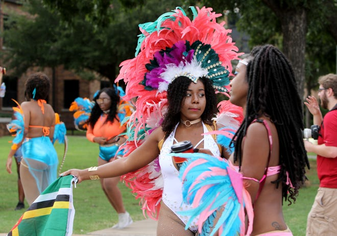 Students dance Saturday, Oct. 6, 2018, in the Caribbean Student Organization Caribfest parade at Midwestern State University.