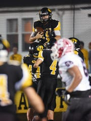 Aiden Fritter is lifted in the air by his Tri-Valley teammates after scoring a first-quarter touchdown in the Scotties' 20-19 overtime win against Sheridan on Friday night at Jack Anderson Stadium.