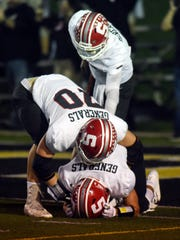 Sheridan's Owen Loughman, left, and Ethan Heller console a teammate following a 20-19 overtime loss to Tri-Valley.