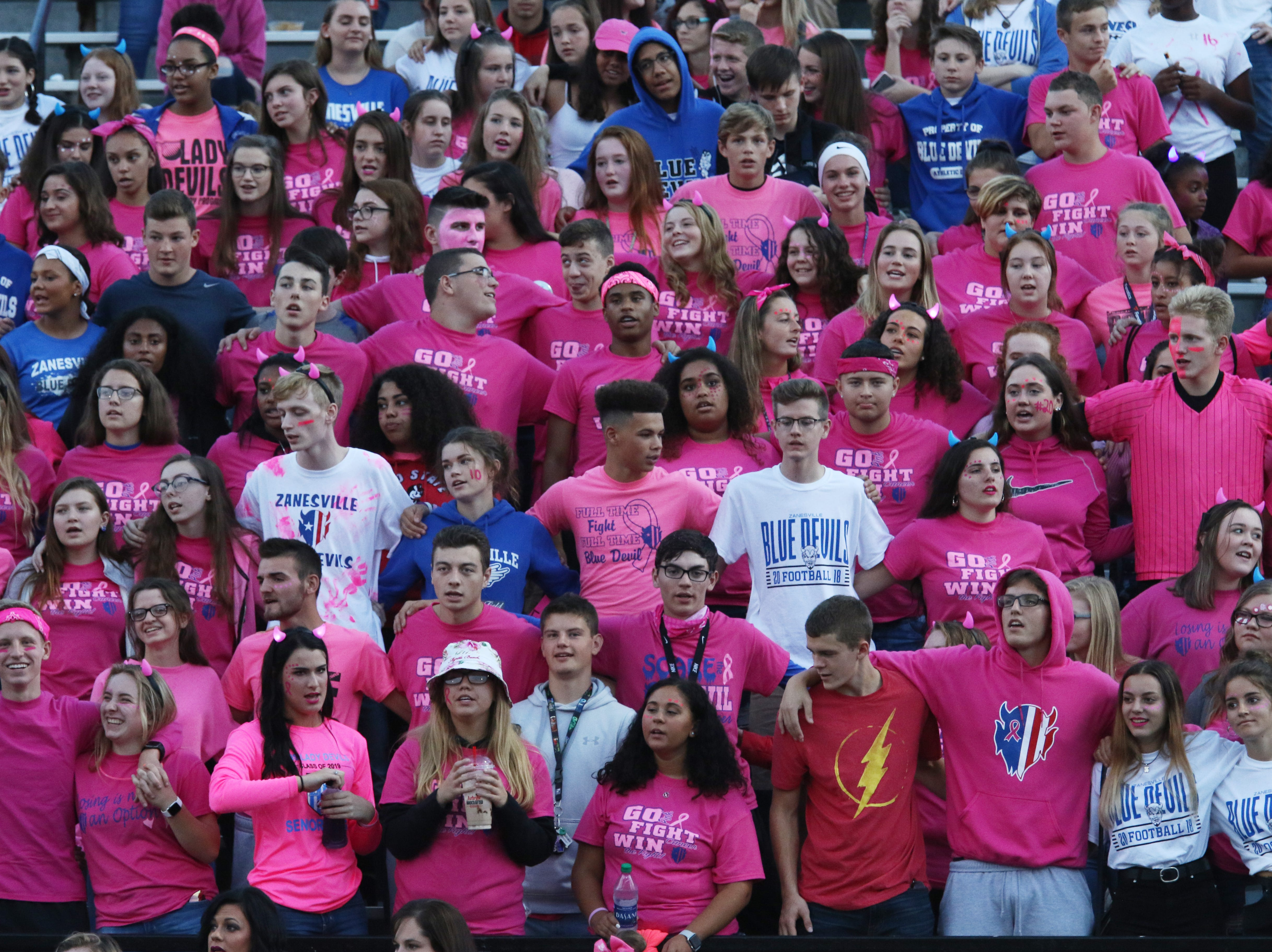 The Zanesville High School student section sings the school's alma mater.