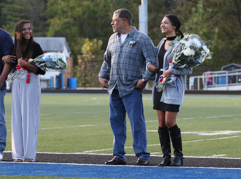 Second sophomore attendant Deja Walker and her grandfather Mark Walker.
