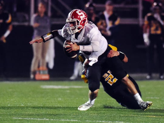Ethan Heller, of Sheridan, is sacked by Tri-Valley's Chase Kendrick earlier this season. Kendrick led the Scotties defense and was the Division II defensive player of the year.