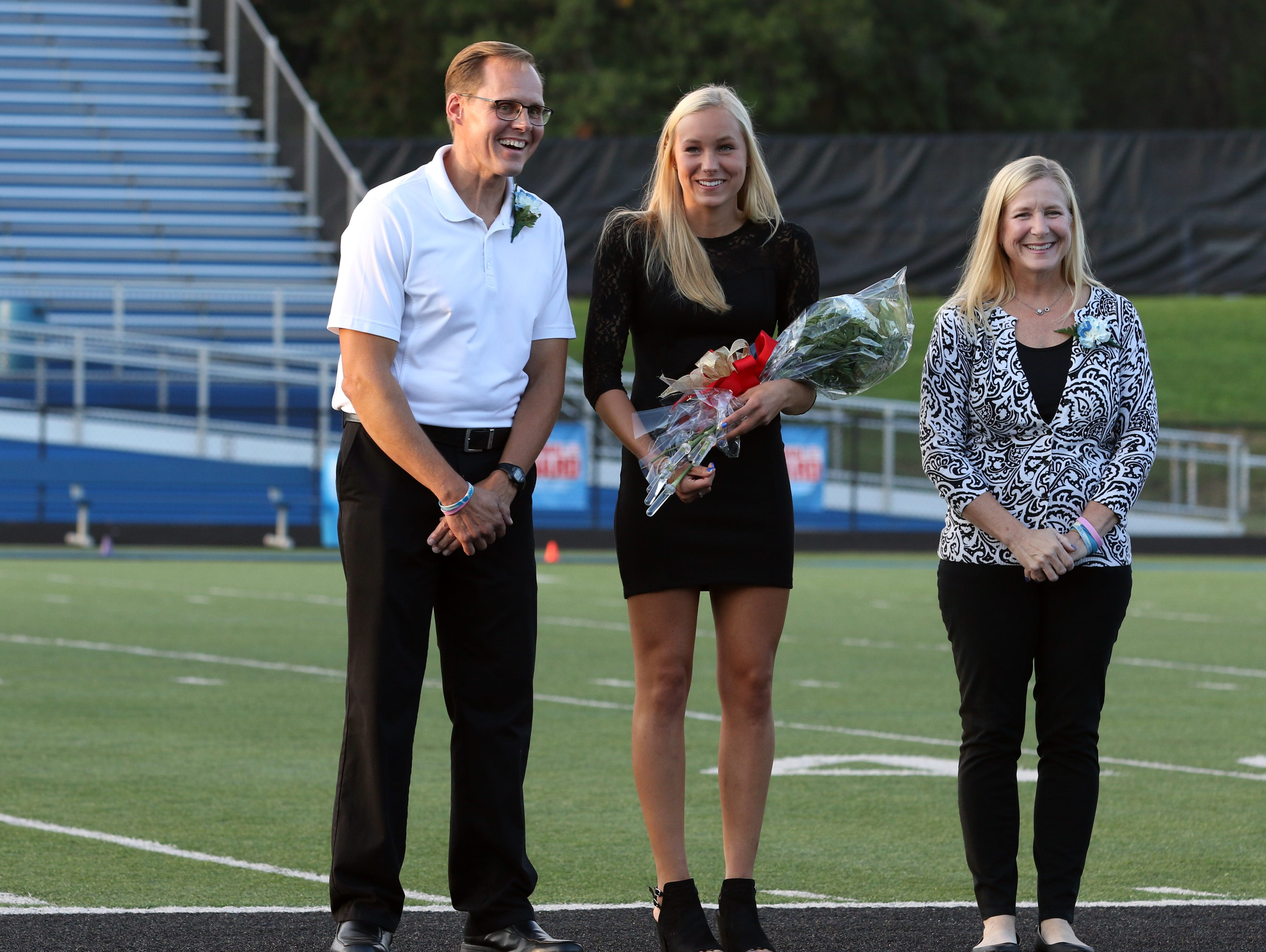 Senior attendant Valerie Hickman and her parents Beth and Brett Hickman.