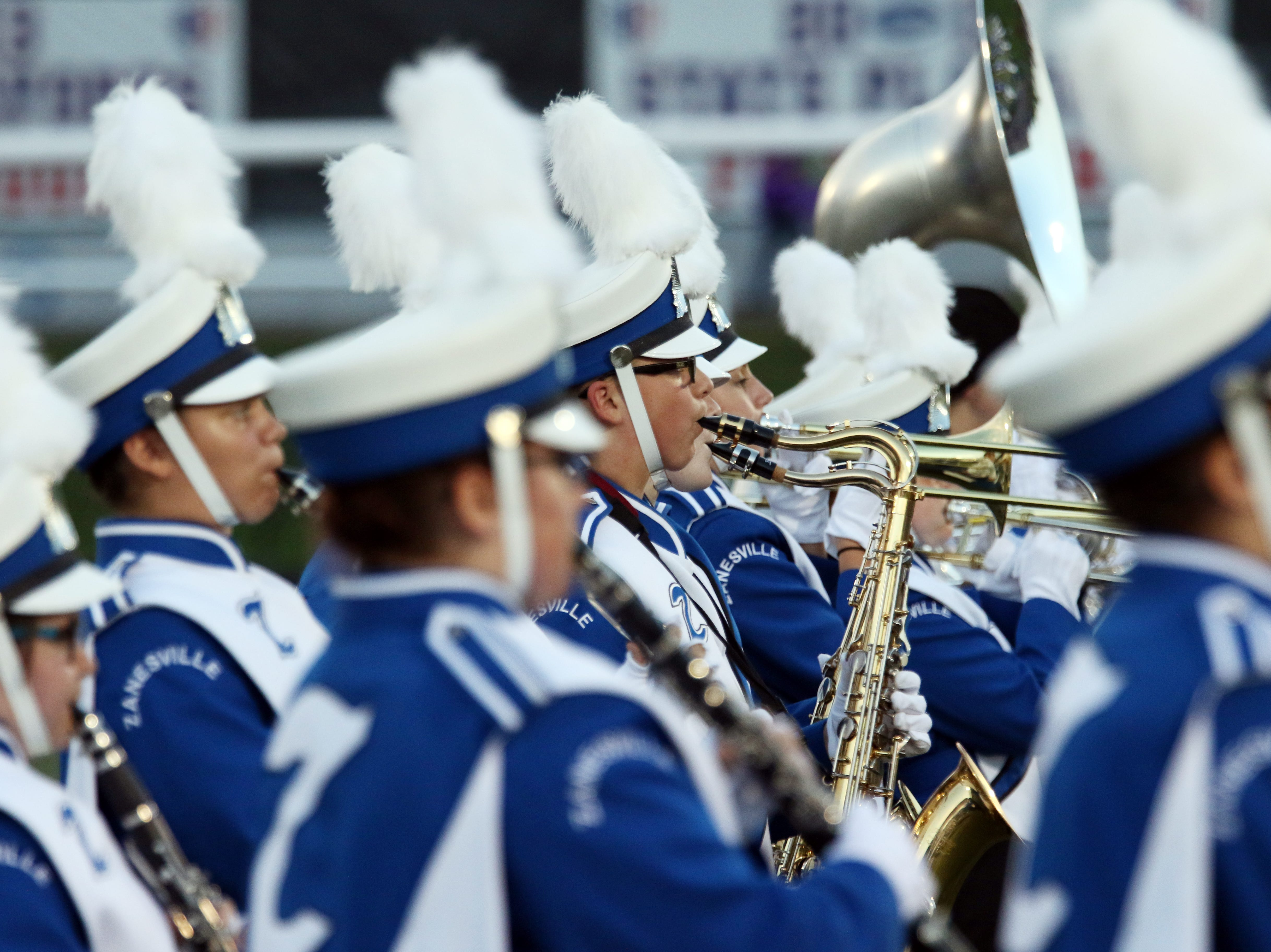 The Zanesville High School marching band performs before Friday's game against Logan.