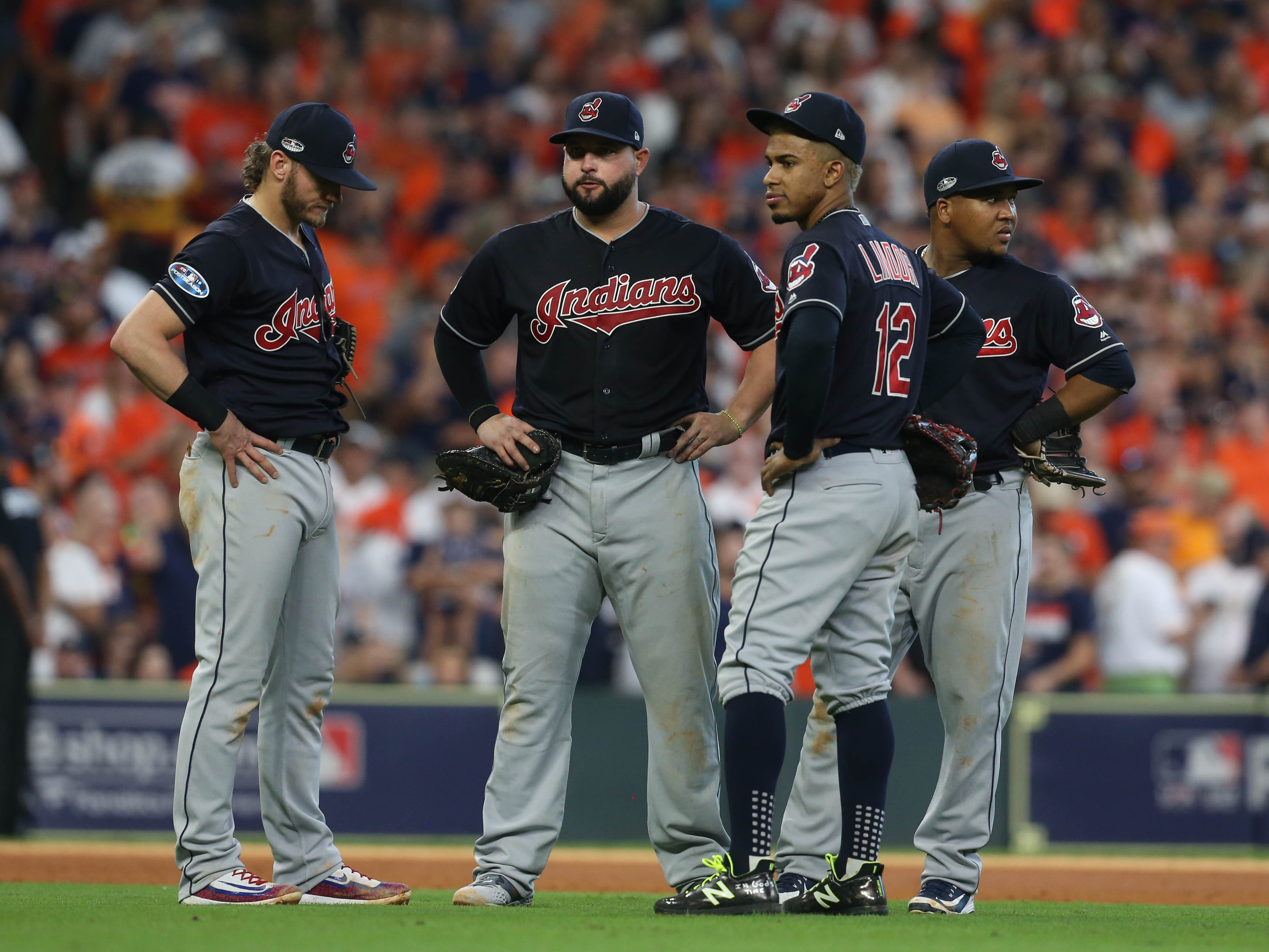 ALDS Game 2: Indians infield meet during a pitching change in the sixth inning.