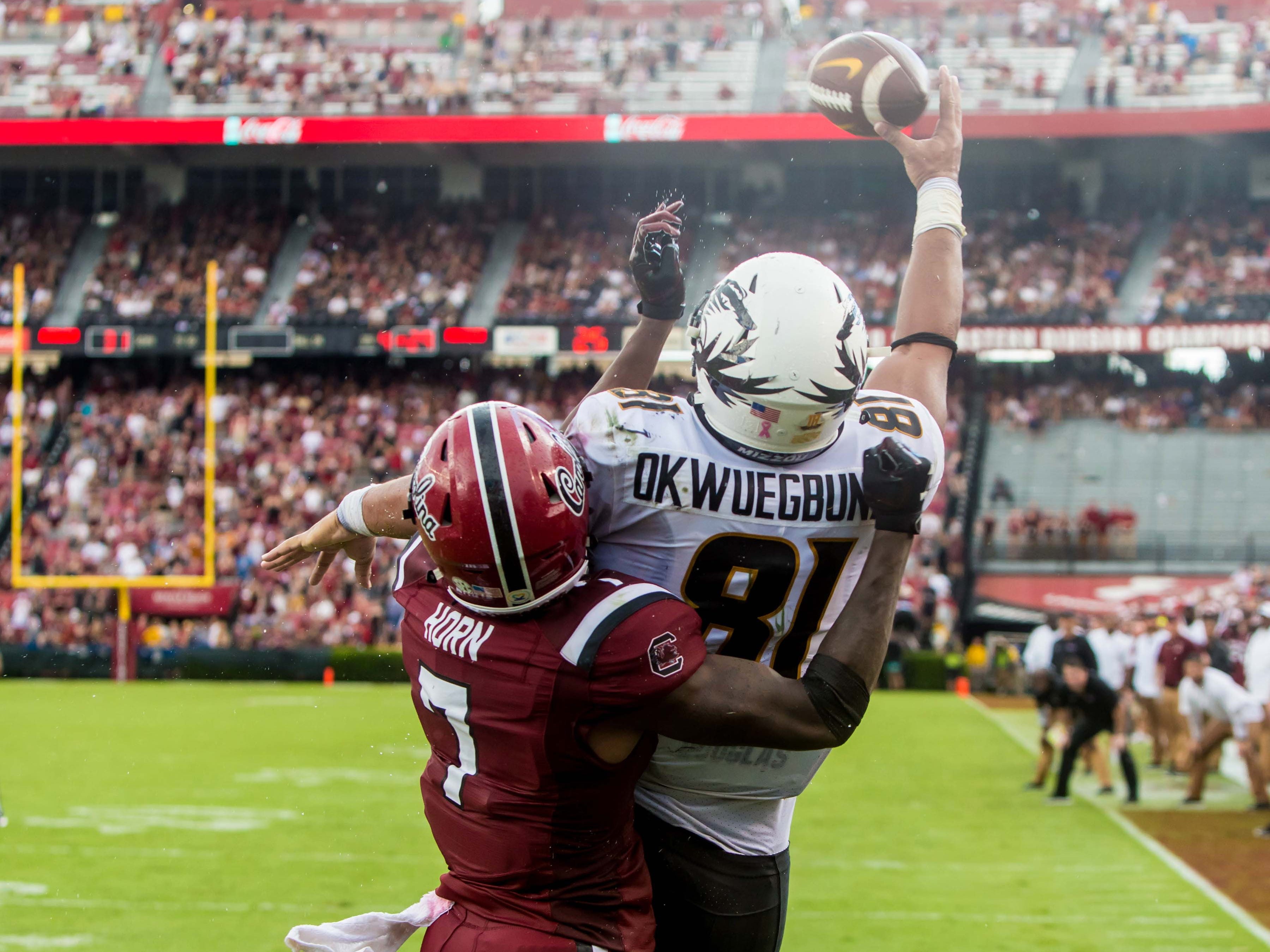 Missouri Tigers tight end Albert Okwuegbunam attempts to make a catch in the end zone as South Carolina Gamecocks defensive back Jaycee Horn defends in the second half at Williams-Brice Stadium.