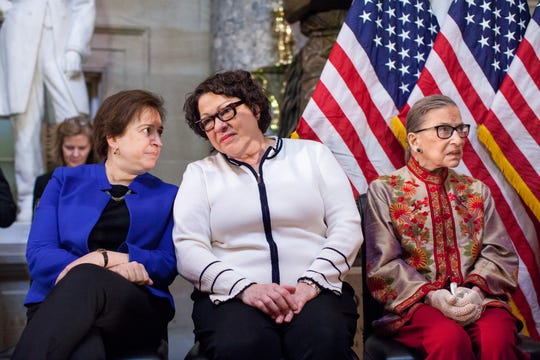 U.S. Supreme Court justices Elena Kagan, Sonia Sotomayor and Ruth Bader Ginsburg, participate in an annual Women's History Month reception hosted by Democratic House Leader Nancy Pelosi in the U.S. capitol building on Capitol Hill in Washington, D.C.