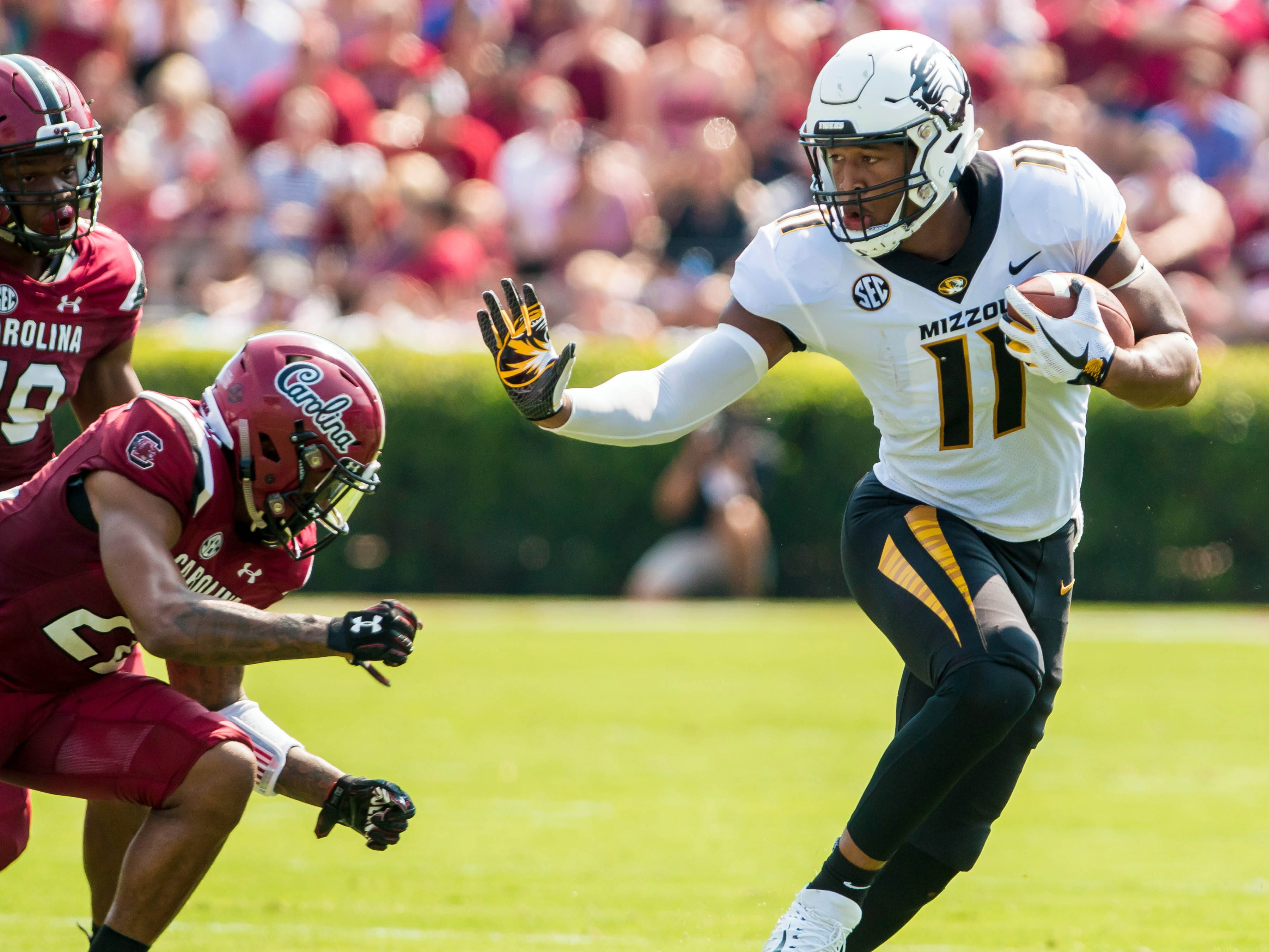 Missouri Tigers tight end Kendall Blanton attempts to get around South Carolina Gamecocks defensive back Steven Montac in the first half at Williams-Brice Stadium.