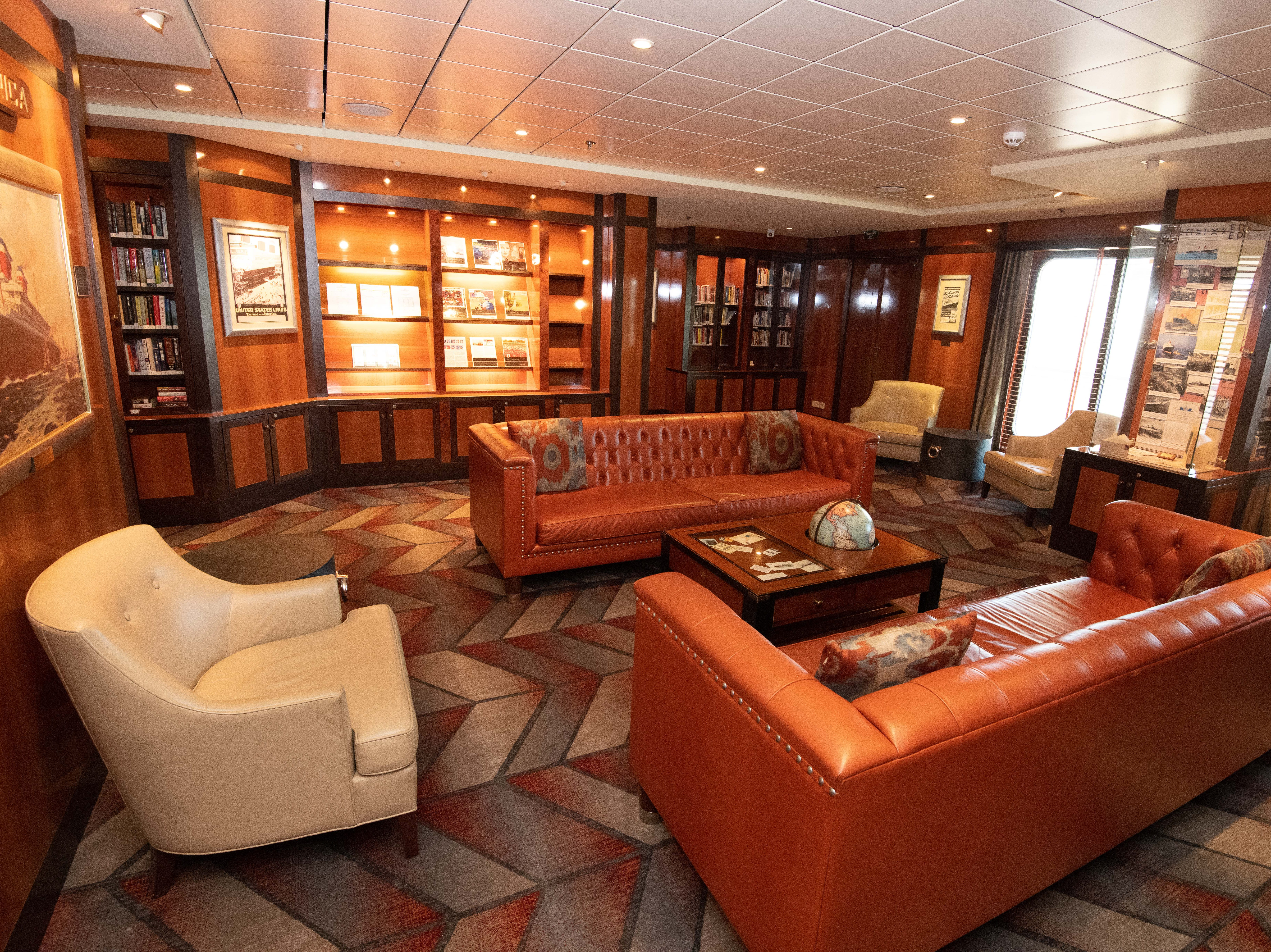 The SS America Library features comfortable leather chairs and sofas.