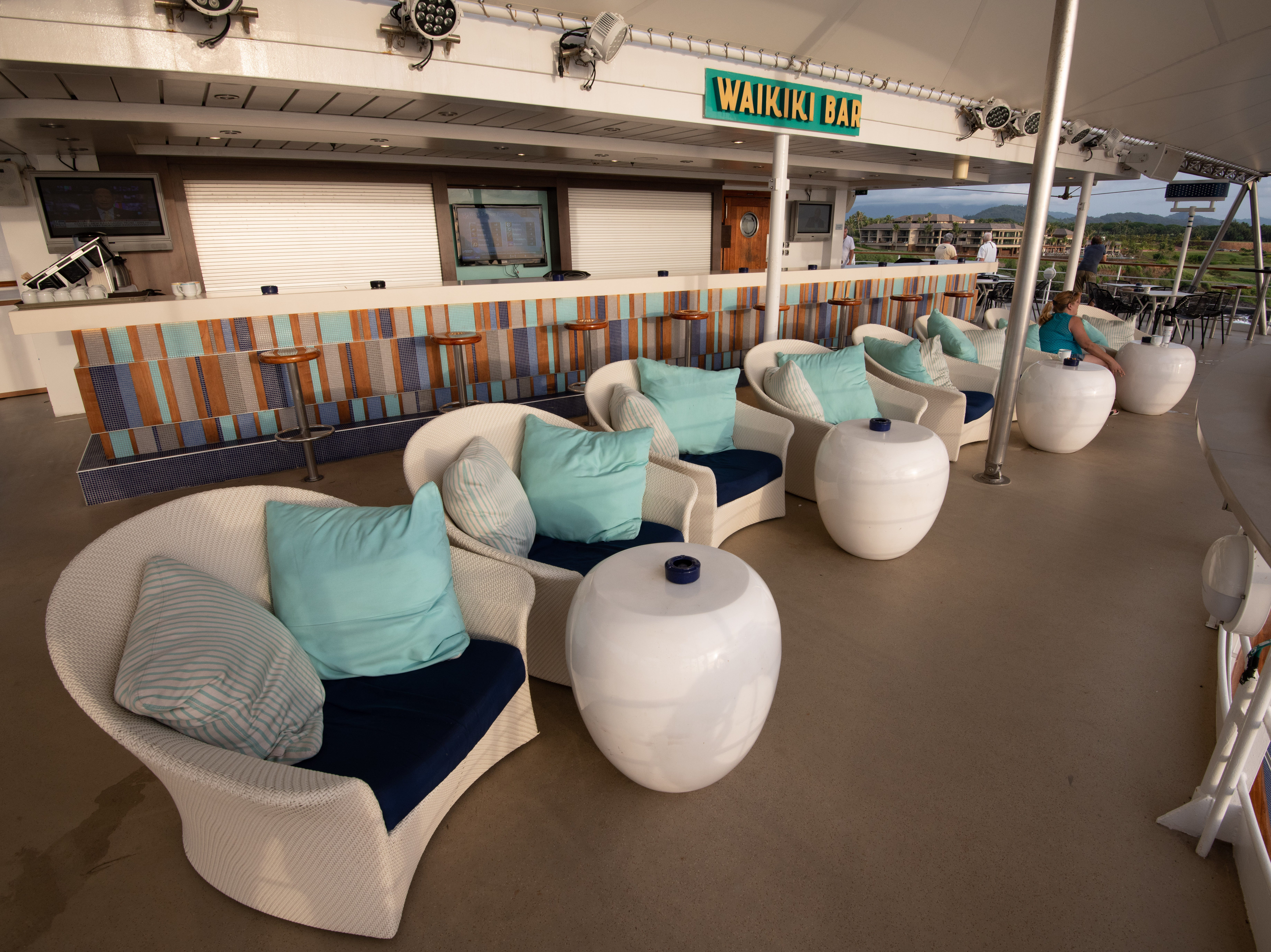 Located on Deck 13 overlooking the Oasis Pool, the surfer-themed, 97-seat Waikiki Bar is one of the few places on Pride of America where passengers can smoke.