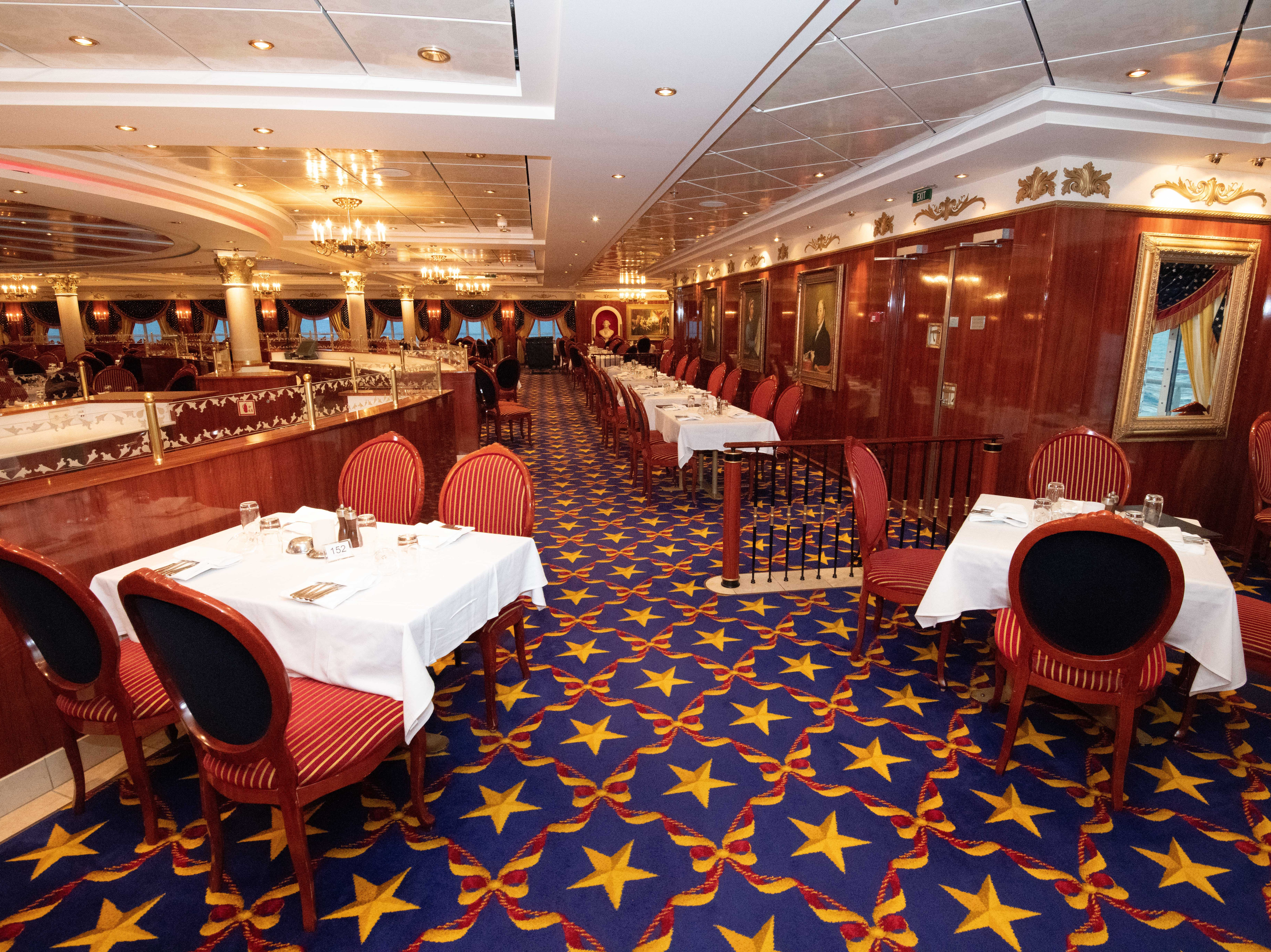 The Liberty Main Dining Room has a patriotic red, white and blue-dominated  decor and serves up classic American cuisine including turkey, roast beef, potatoes and hot apple pie.