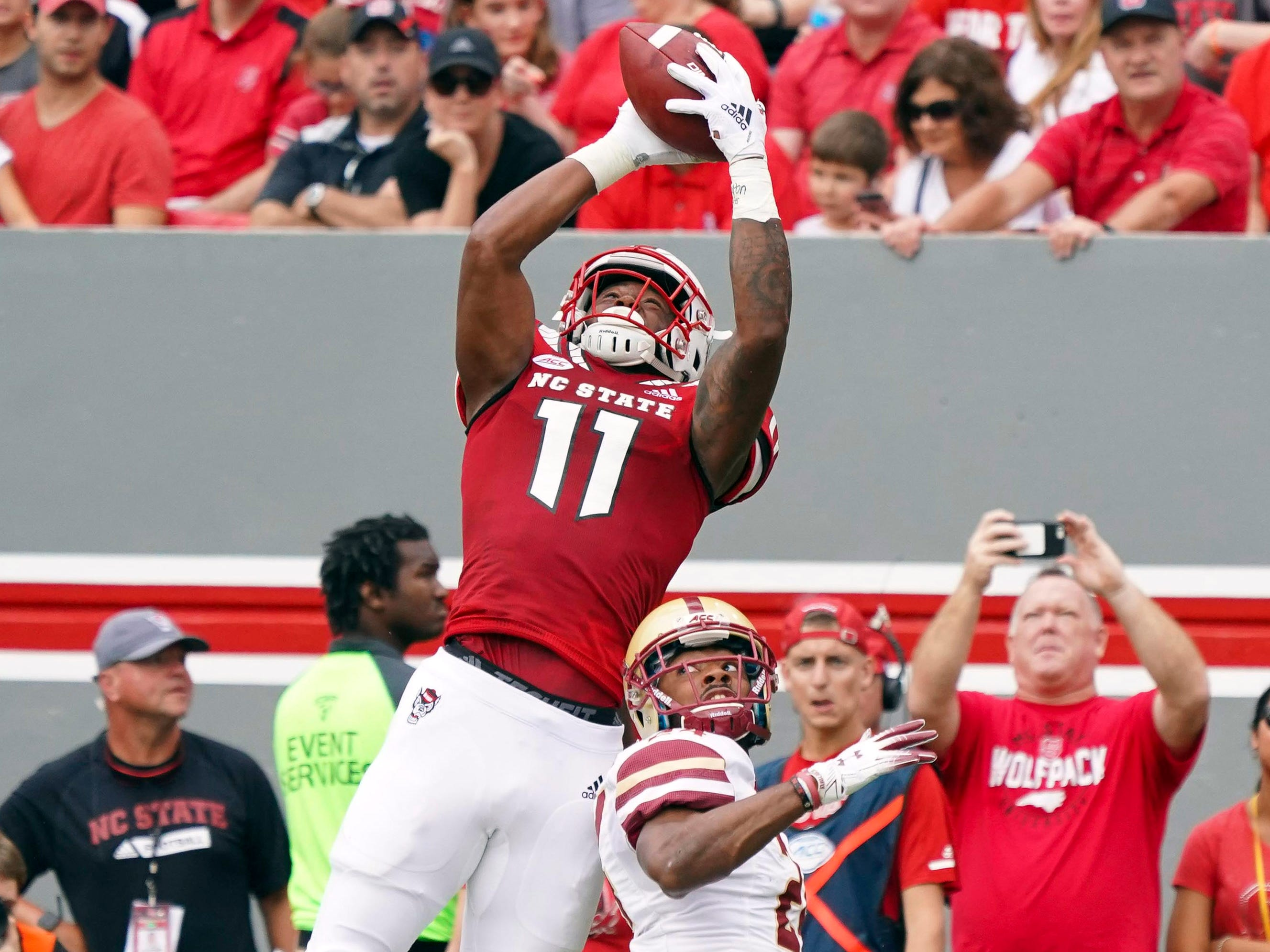 North Carolina State Wolfpack wide receiver Jakobi Meyers makes a catch against Boston College Eagles defensive back Taj-Amir Torres during the first half at Carter-Finley Stadium.