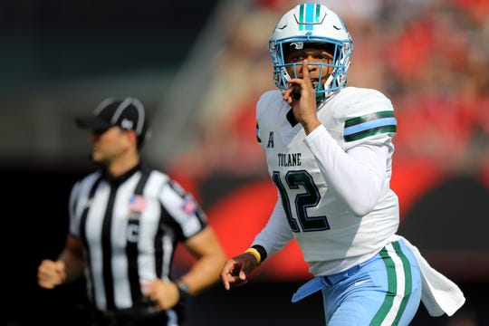 Tulane Green Wave quarterback Justin McMillan reacts to the crowd after throwing a touchdown against the Cincinnati Bearcats in the first half at Nippert Stadium.