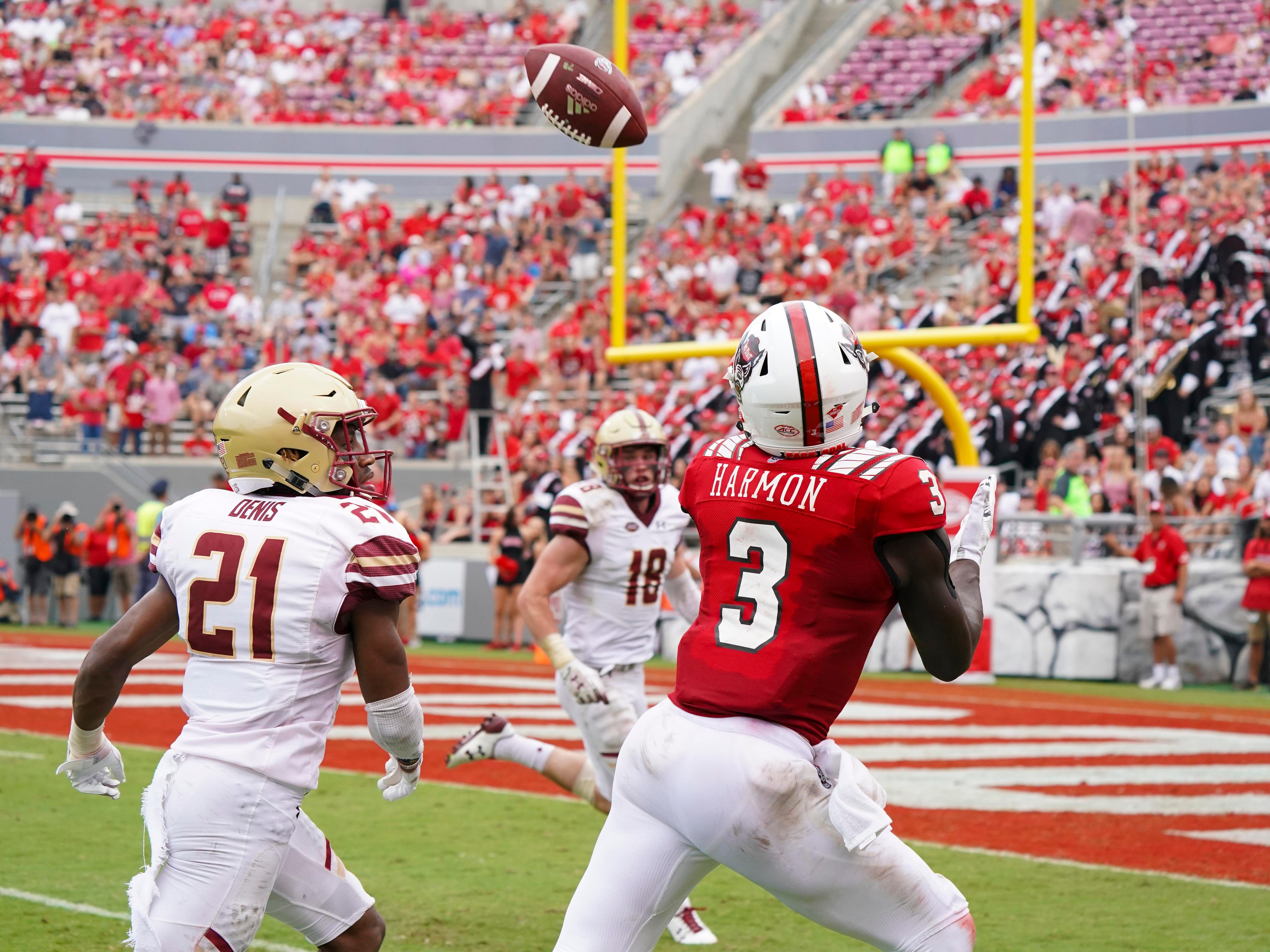 North Carolina State Wolfpack wide receiver Kelvin Harmon catches a touchdown pass against Boston College Eagles defensive back Lukas Denis during the second half at Carter-Finley Stadium.